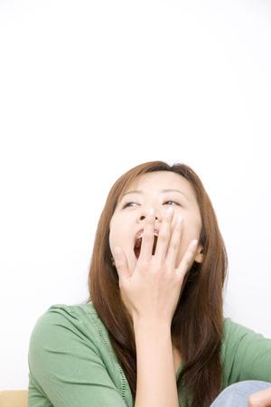 sleepiness: Woman yawn Stock Photo