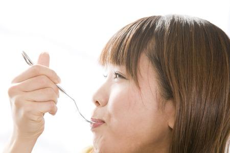 woman eating cake: Woman eating cake Stock Photo