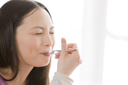 exhilaration: Woman eating cake Stock Photo