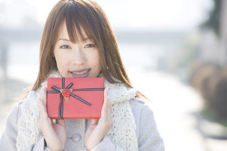 Woman holding chocolate photo
