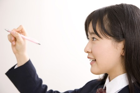 Middle school girls with a mechanical pencil