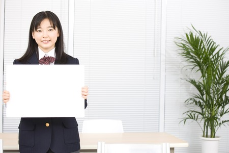 junior: Junior high school girl with a message board Stock Photo