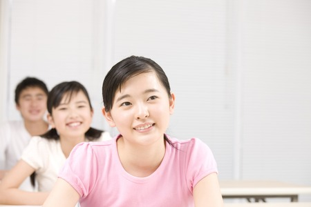 cram: Men and women you are studying in cram school Stock Photo