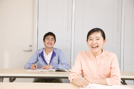 Men and women you are studying in cram school Stock Photo