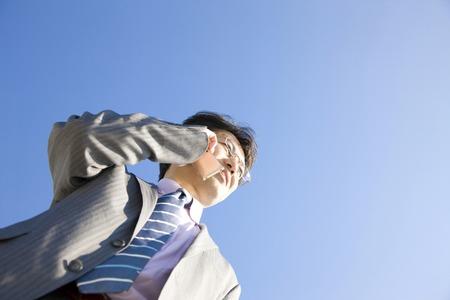 通信: Businessman on mobile phone calls 写真素材