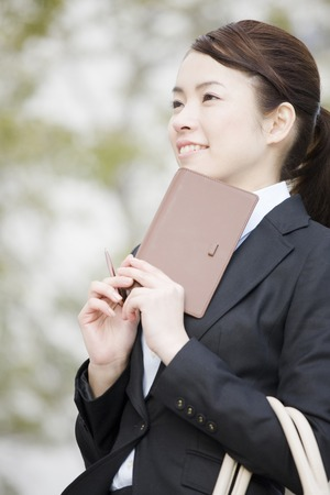 rely: OL that is the thinking rely on the notebook to the chin Stock Photo