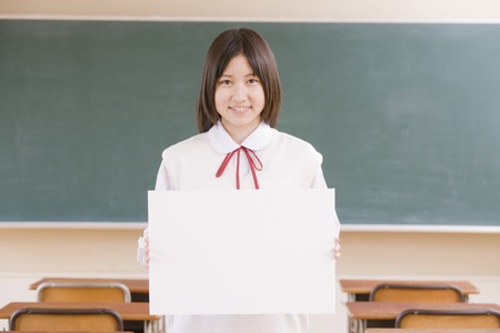 Womens junior high school students in the classroom with the message board Stock Photo