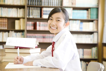 Women's junior high school students to study in the library 写真素材