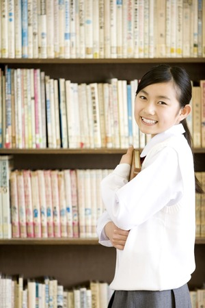 10's: Junior high school girls with a book Stock Photo