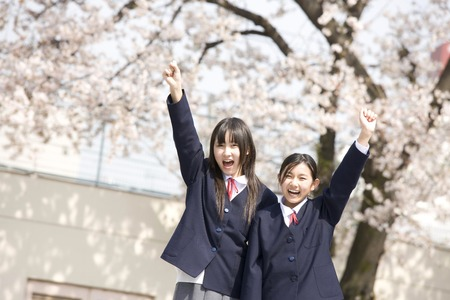 10's: Two female junior high school students to the guts pose Stock Photo