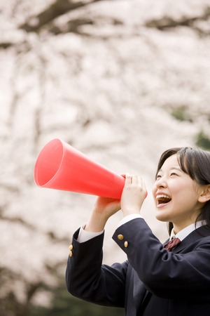 Female junior high school students to shout using a megaphone