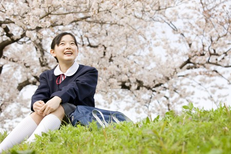 10's: Junior high school girl sitting on the hill
