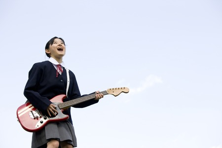 Women play the guitar junior high school students Stock Photo