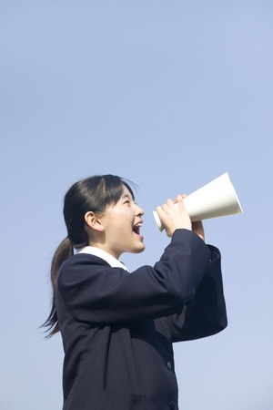 junior high: Junior high school girls to issue a loud megaphone Stock Photo