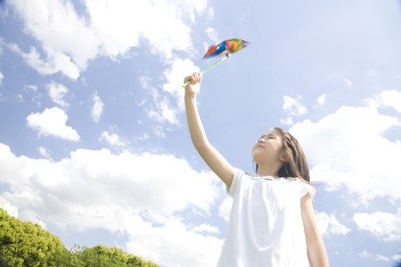 Girl playing with windmill