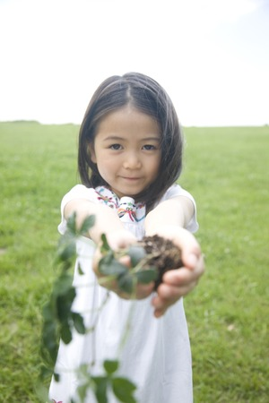 green life: Girl with a plant