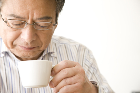sixty: Senior man drinking coffee Stock Photo
