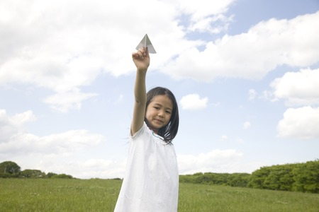 green life: Girl with a paper airplane