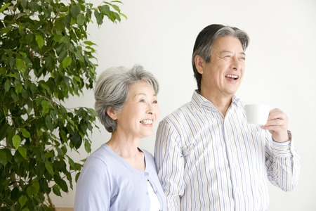 laughs: An elderly couple have to laugh Stock Photo