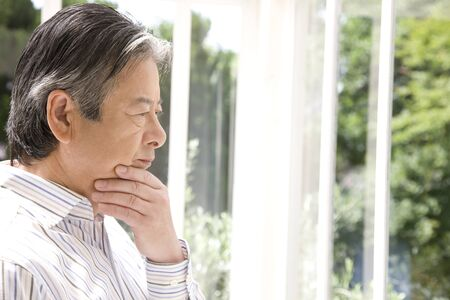 lost in thought: Senior men who lost in thought Stock Photo