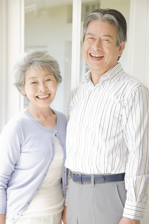 old people smiling: An elderly couple have to laugh Stock Photo