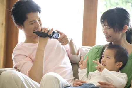 nuclear family: Father to shoot his son to be embraced by the mother in the video camera