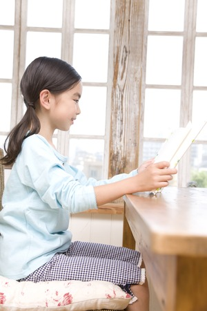 living beings: Girl reading book Stock Photo