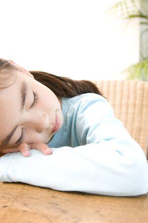 sleepiness: Girl sleeping in desk Stock Photo