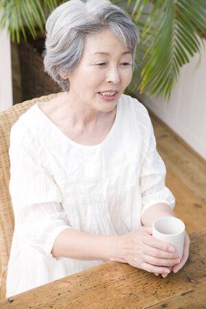 woman drinking tea: Senior woman drinking tea
