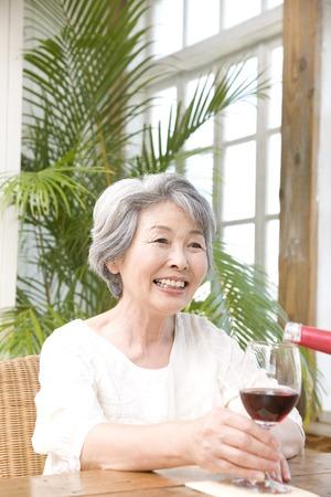 poured: Senior woman poured wine