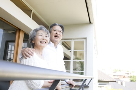 Elderly couple laughing on the veranda