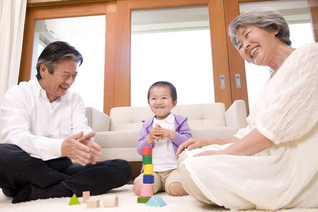 japanese people: Old couple playing with grandchildren