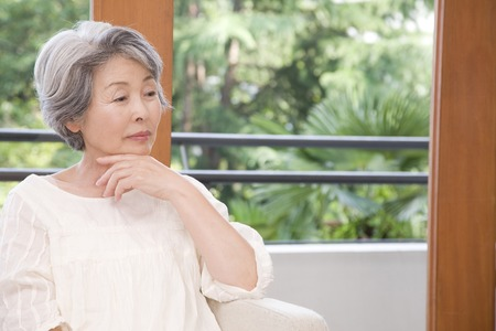 negative thinking: Senior women who are lost in thought
