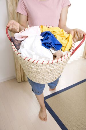 laundry basket: Hand of the woman with a laundry basket Stock Photo