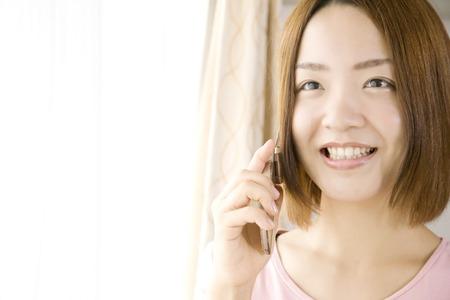 通信: 女性に電話する