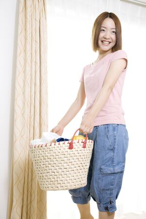 laundry basket: Woman with a laundry basket