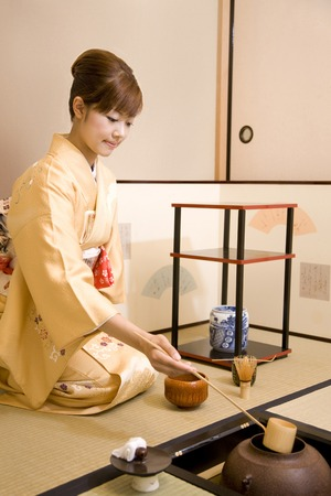japanese green tea: Women scoop the hot water in the dipper Stock Photo