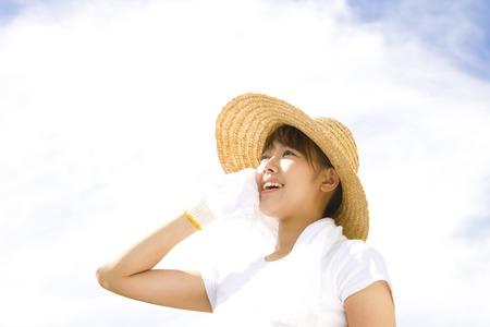 field work: Women wipe the sweat during field work