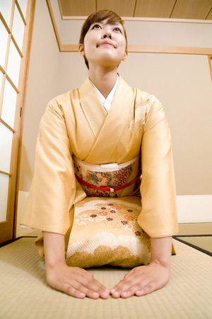 Womens kimono to kneel Stock Photo