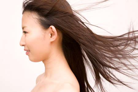 wavering: Women hair is fluttering in the wind Stock Photo