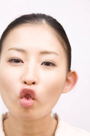 pucker: Women pucker the mouth