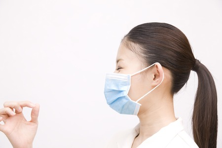 dental hygienist: Dental hygienist wearing a mask