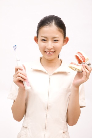 dental hygienist: Dental hygienist to perform a toothpaste guidance Stock Photo