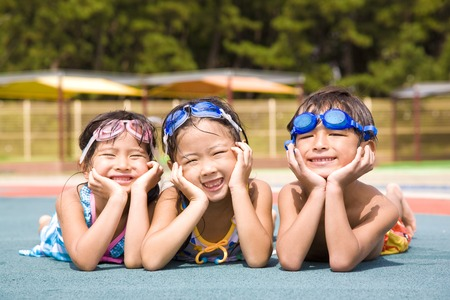 a bathing place: Children swimsuit that is laughing Stock Photo