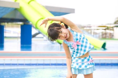 a bathing place: Girls swimsuit to warmingup exercises