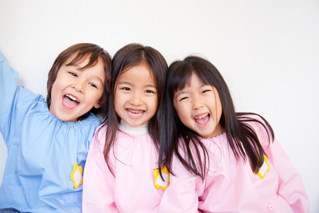 Kindergarten three smile Standard-Bild