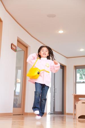 Kindergarten girl running down the hallway