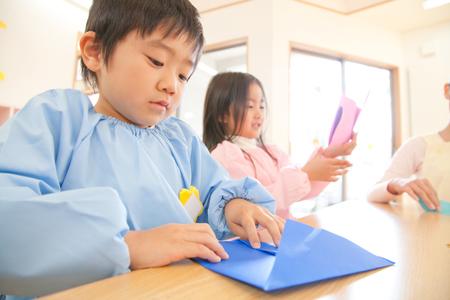 kindy: Kindergarten boy fold origami