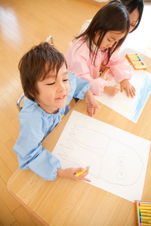 children painting: Kindergarten children to enjoy painting Stock Photo