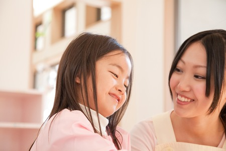 smocking: Kindergarten girls and kindergarten teachers of smile